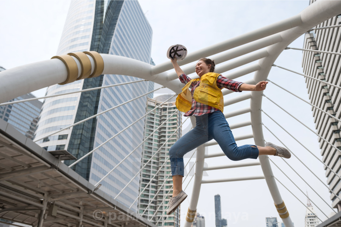 """Happy American engineer jump in city"" stock image"