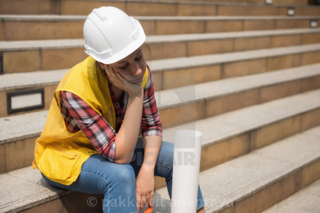 Tired American female engineer in city - License, download or print