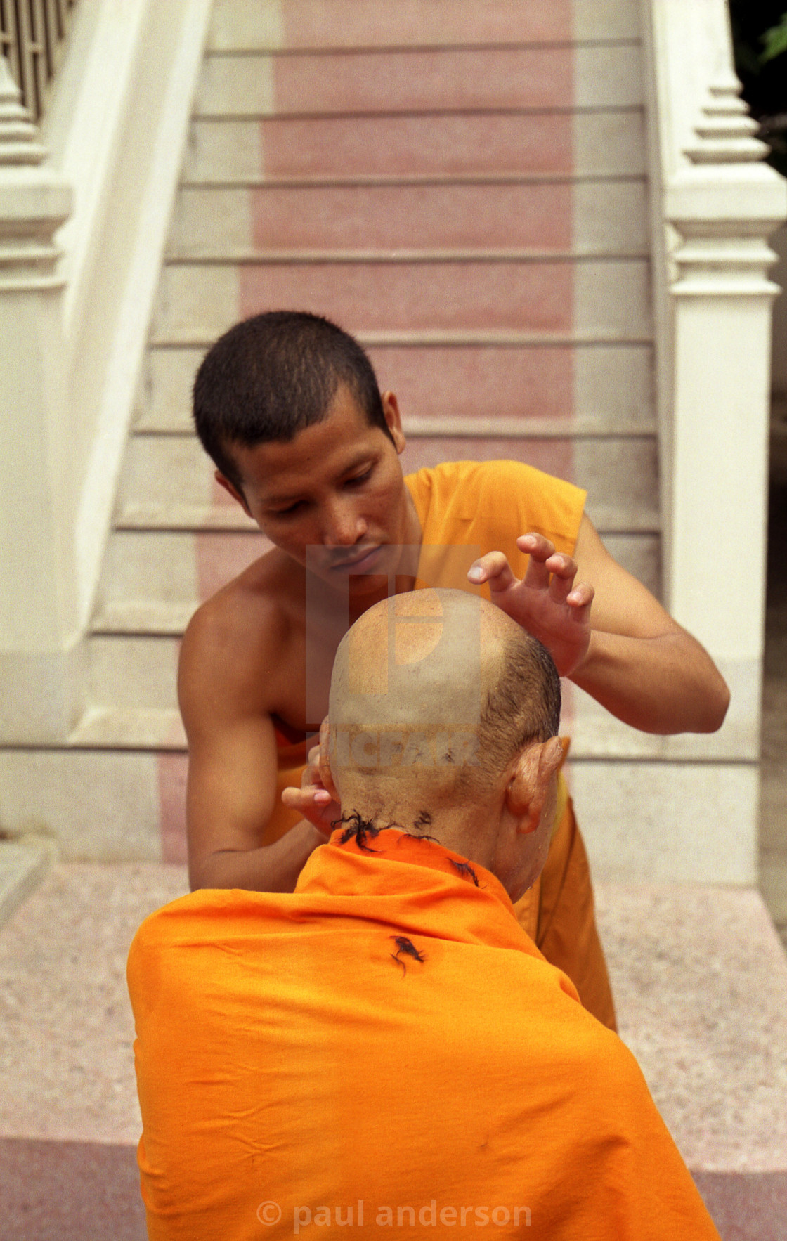 """Buddhist priest having haircut in Bangkok"" stock image"