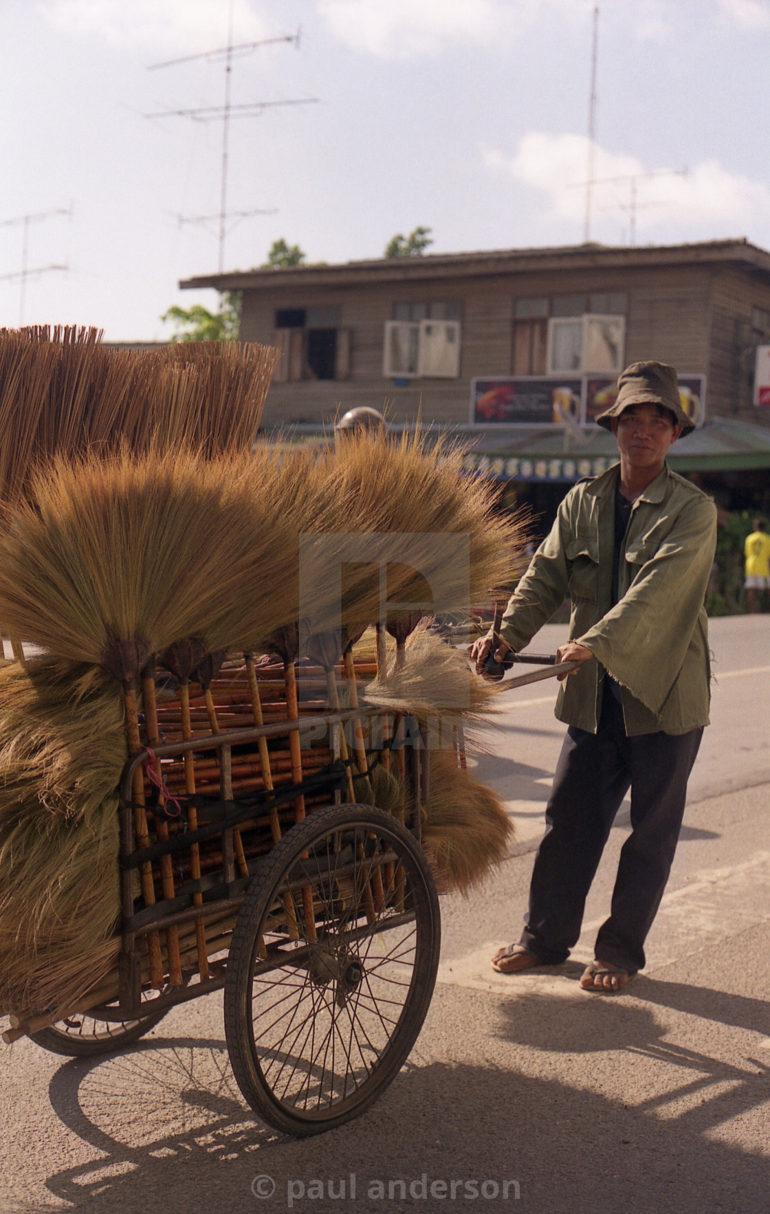 """A brush seller in Cambodia"" stock image"
