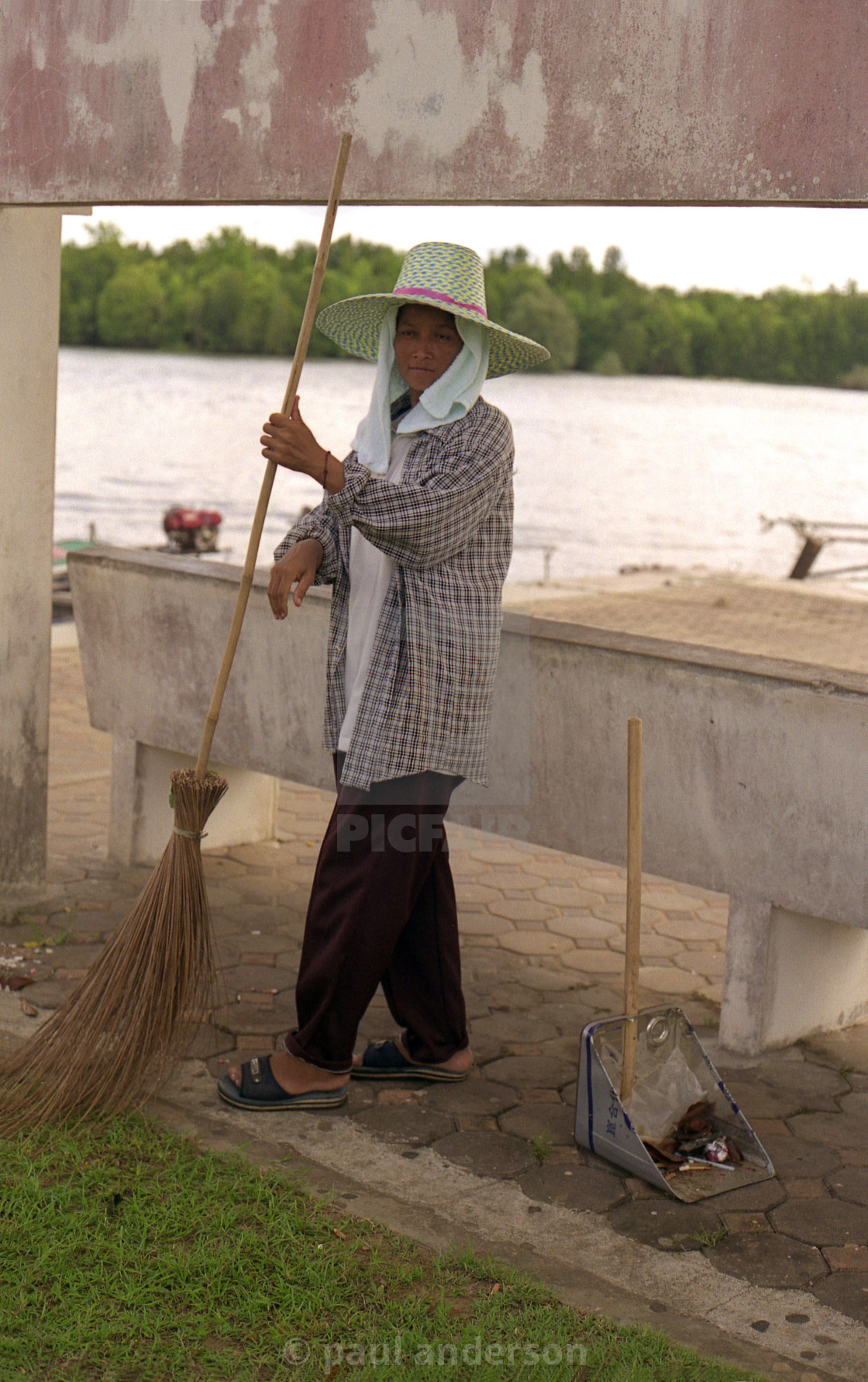 """A female street cleaner in Cambodia"" stock image"