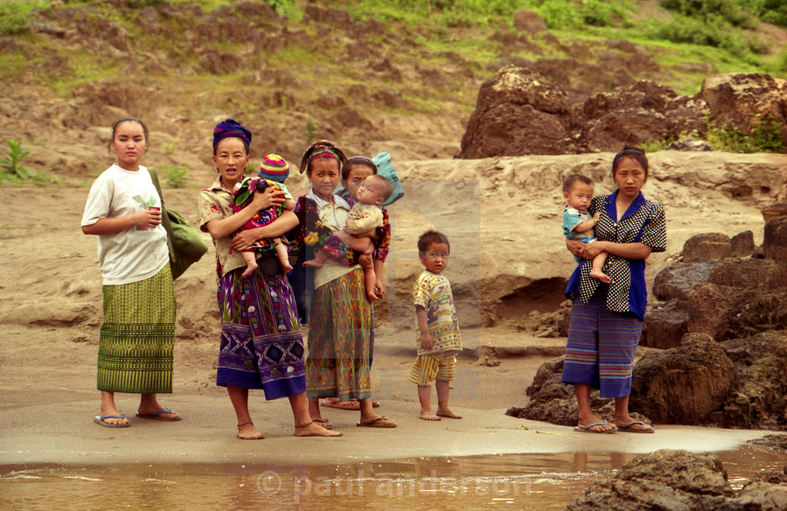 """Family on the Mekong River in Laos"" stock image"
