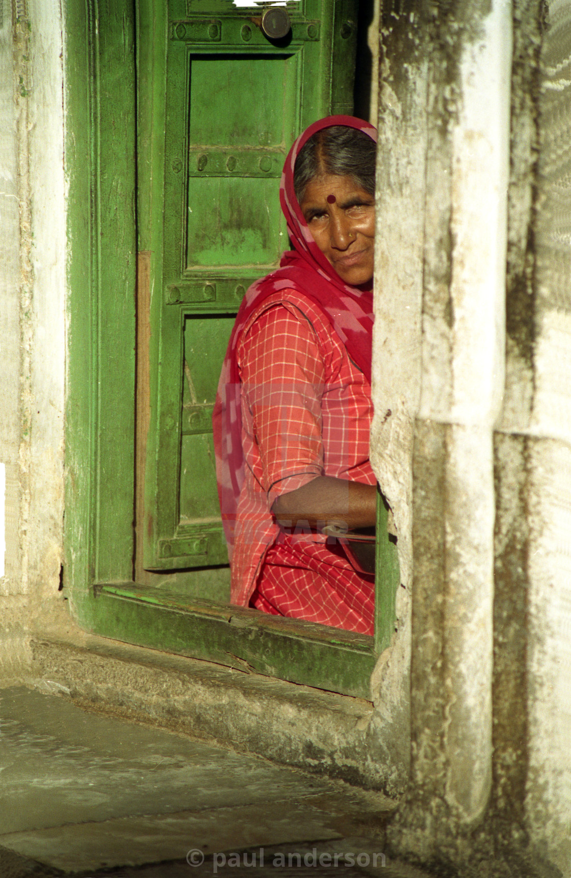 """Woman in doorway in India"" stock image"