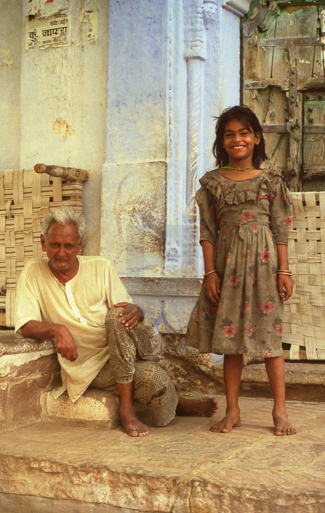 """Grandfather and grand-daughter in India"" stock image"
