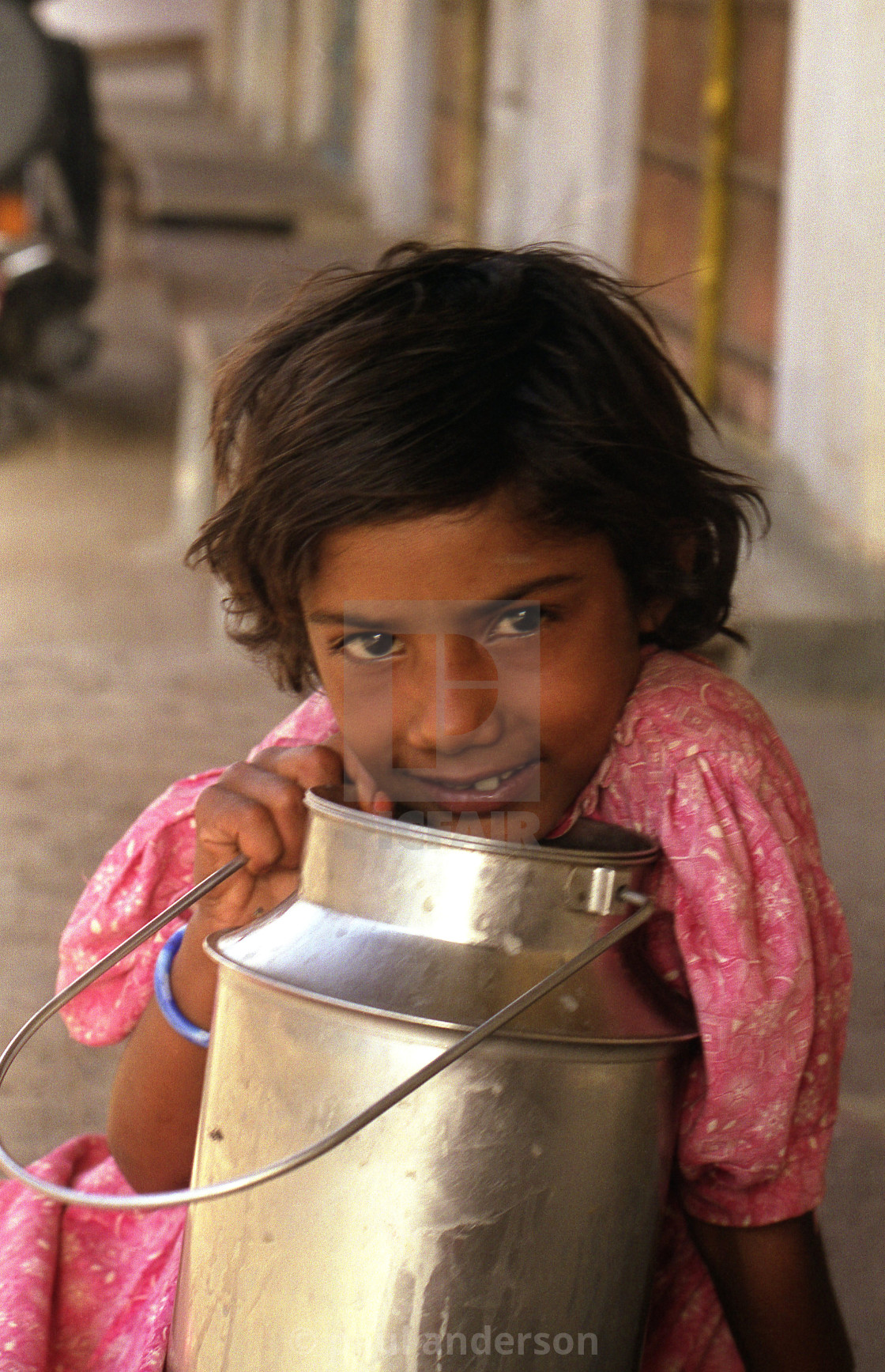 """A young girl in the street of India"" stock image"