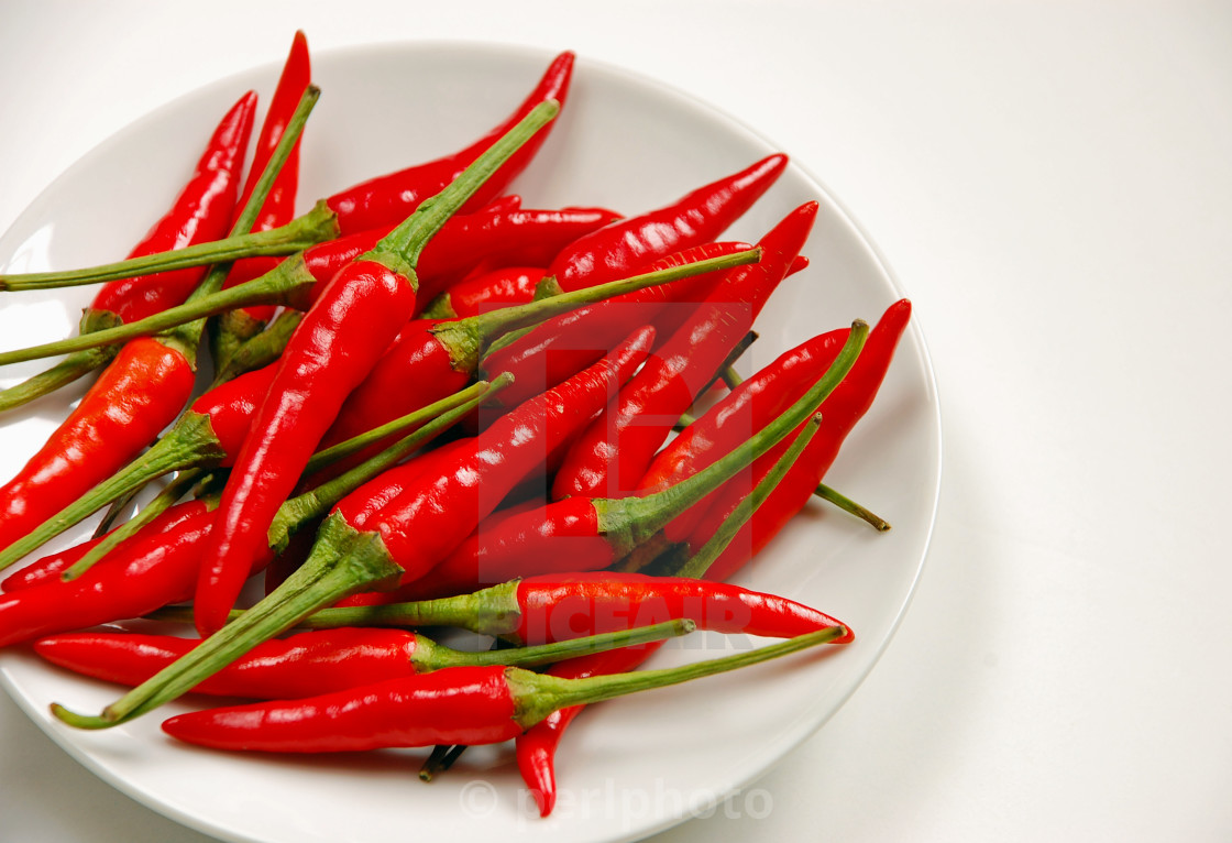 """Chili peppers on white plate"" stock image"