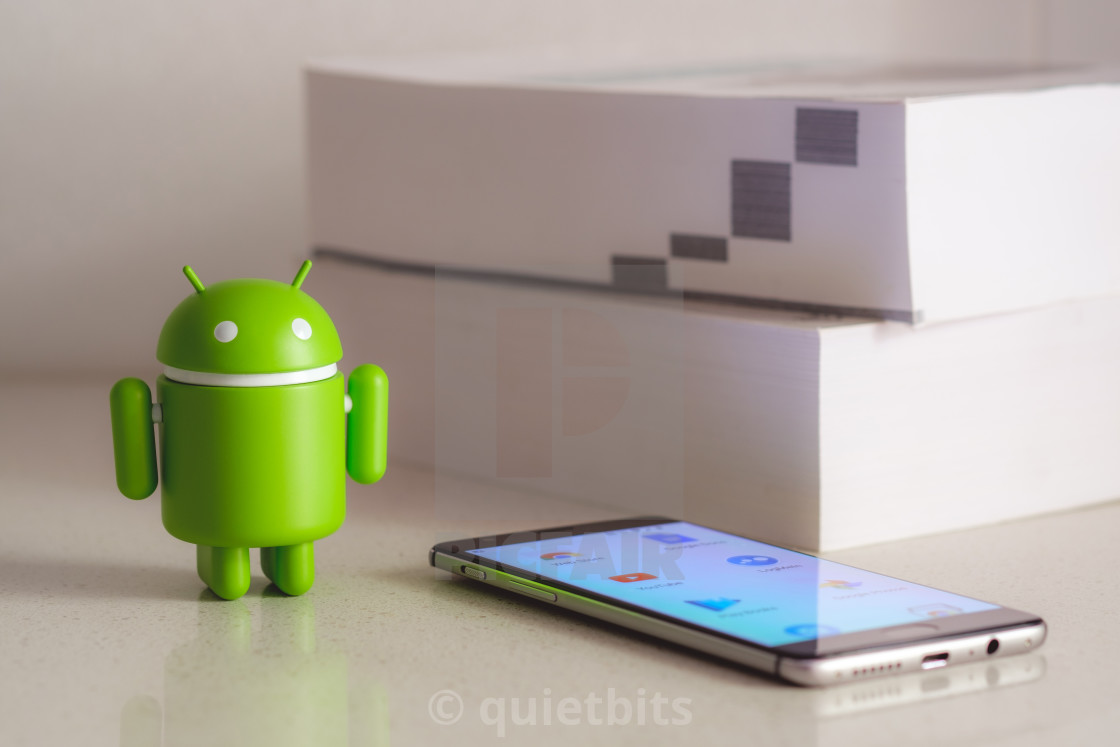 Google Android figure with books in the background - License
