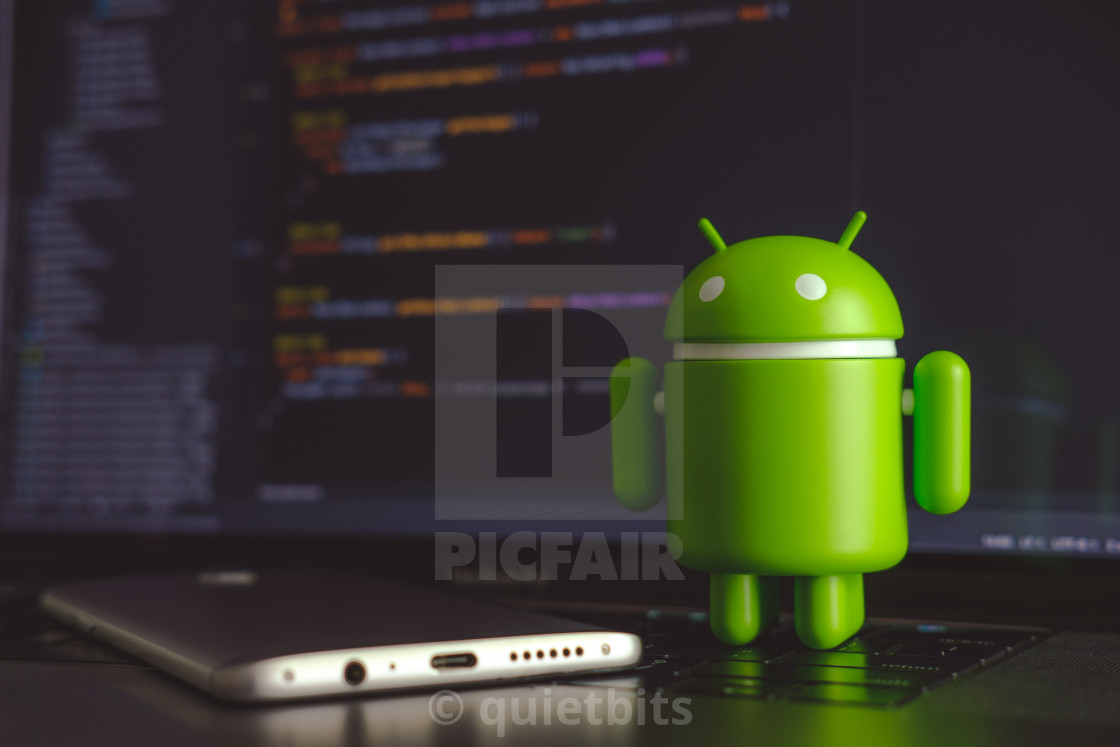 Google Android figure standing on laptop keyboard - License