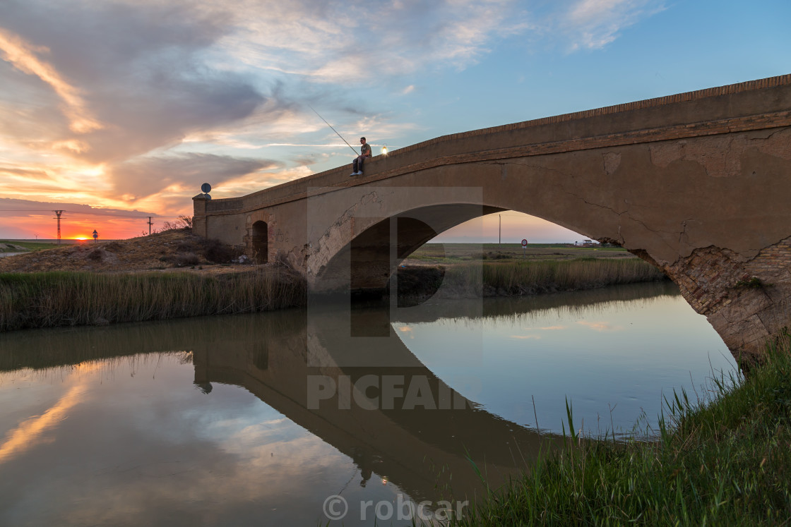 """Man fishing in river"" stock image"