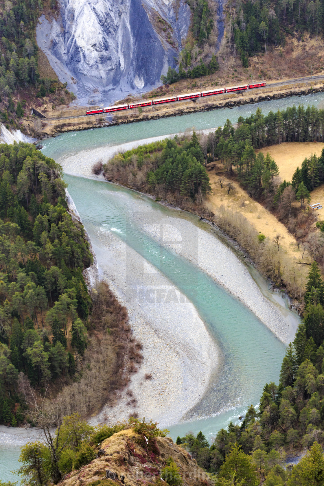 """The red train travels along the Rhine River. Rhein Gorge(Ruinaulta), Flims,..."" stock image"