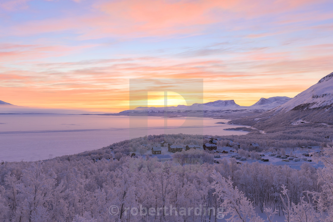 """Sunrise illuminates Bjorkliden houses and camping. Bjorkliden, Norbottens..."" stock image"