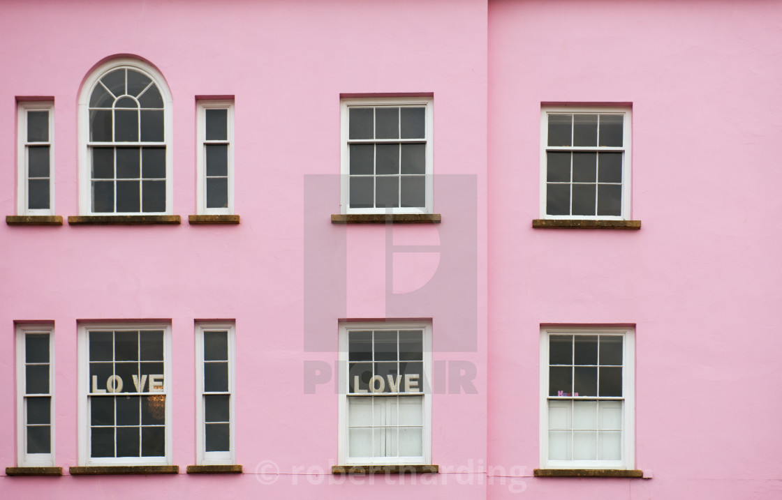 """Pink house with love signs in the window"" stock image"