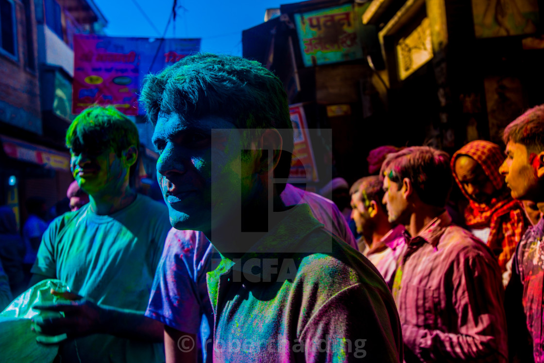 """Men covered in pigment, Pigment throwing Holi Festival, Vrindavan, India"" stock image"