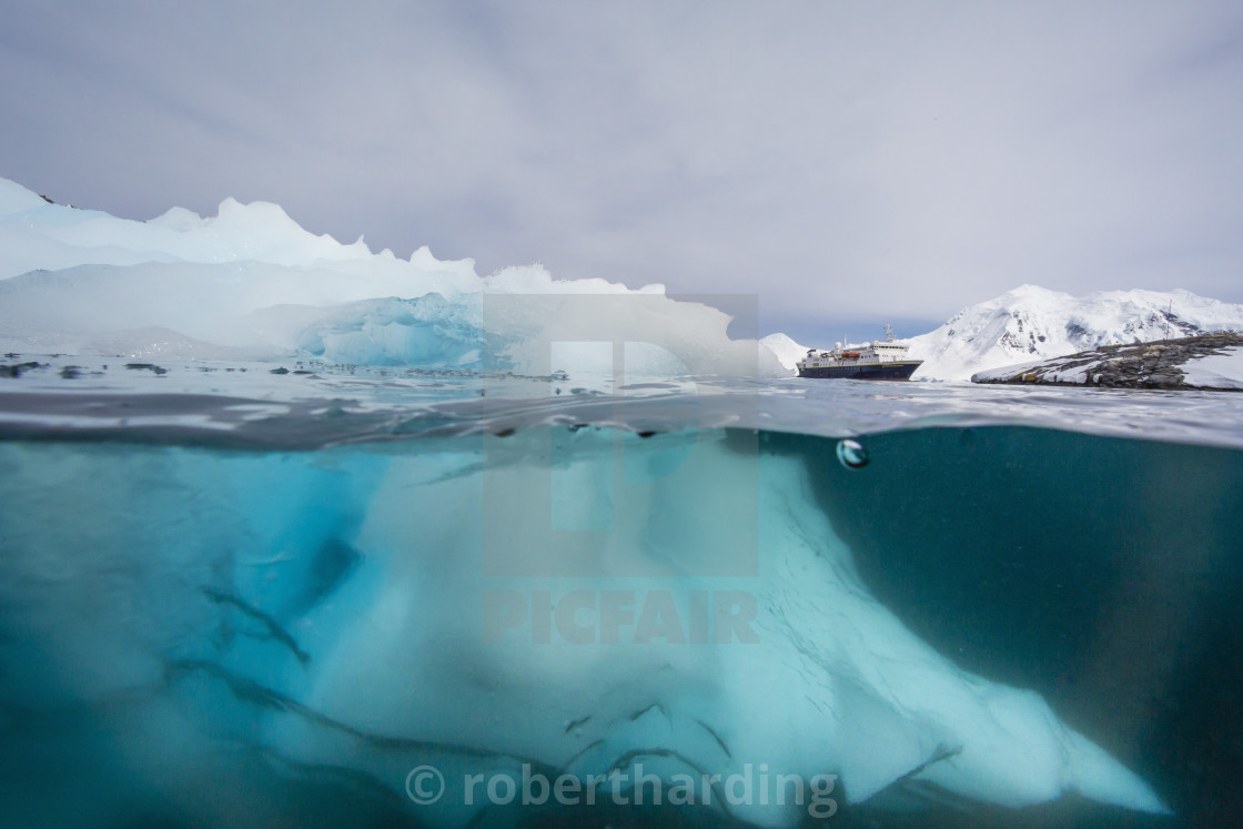 """Above and below view of glacial ice near Wiencke Island, Neumayer Channel,..."" stock image"