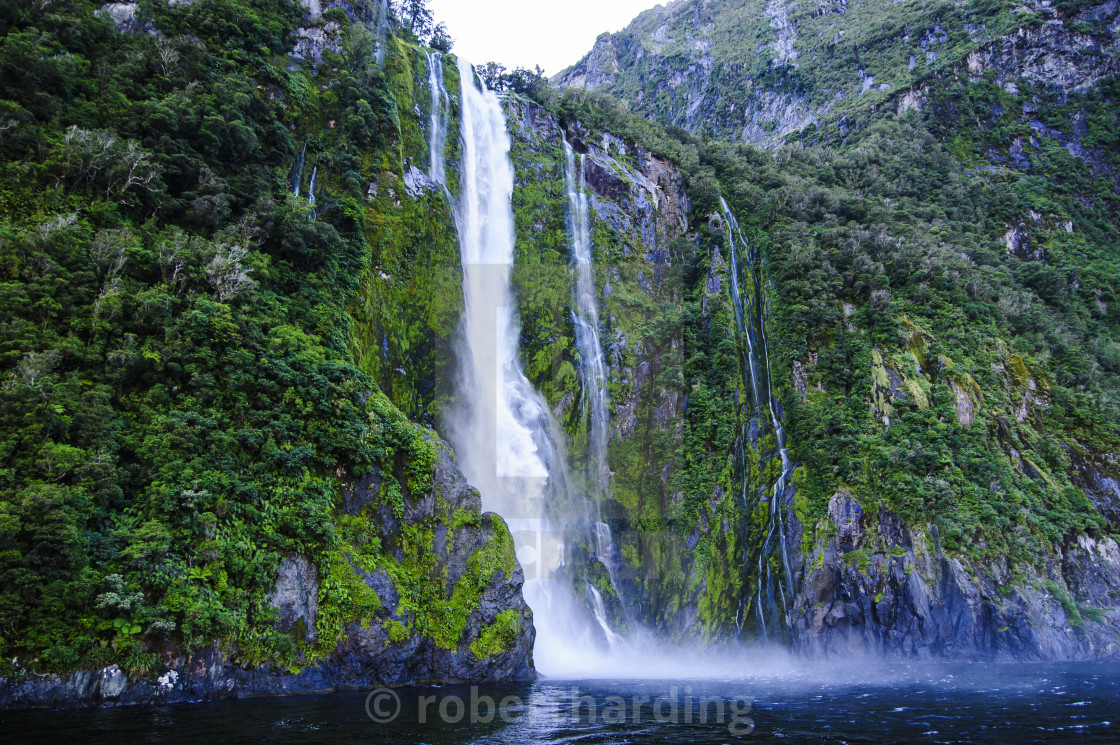 Huge Waterfall In The Milford Sound South Island New Zealand