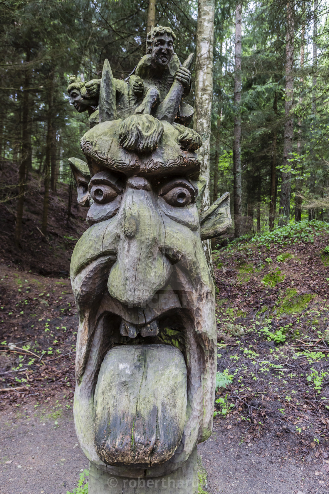 """Wood carvings from traditional folklore at The Hill of Witches on the Dano..."" stock image"