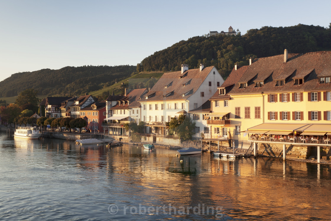 """""""Old town along the Rhine promenade with Burg Hohenklingen castle at sunset,..."""" stock image"""