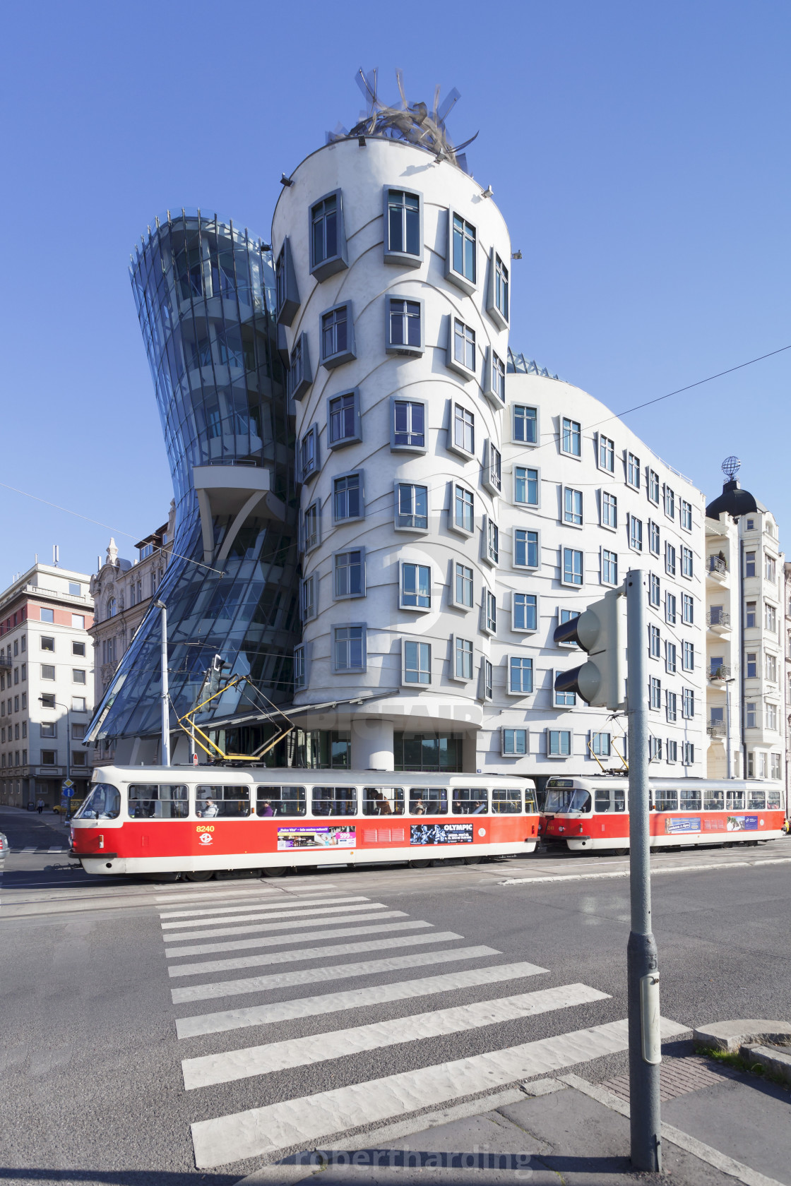 """Tram in front of the Dancing House (Ginger and Fred) by Frank Gehry, Prague,..."" stock image"