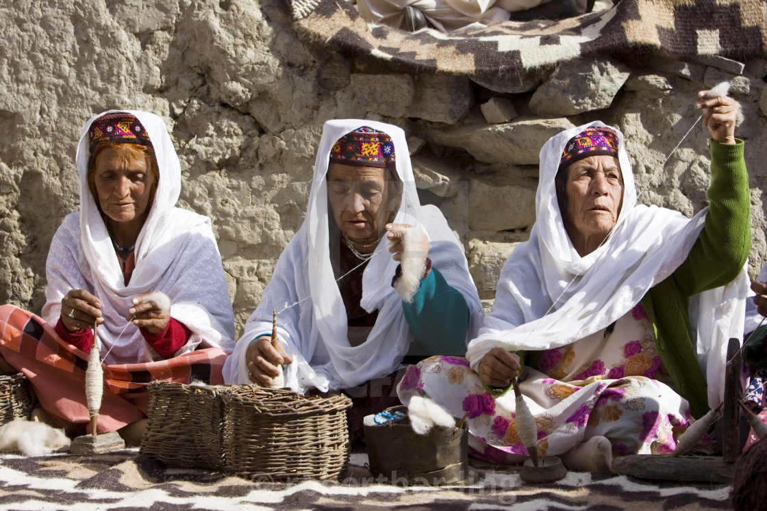 """Women spin wool together in mountain village of Altit in Hunza region of..."" stock image"