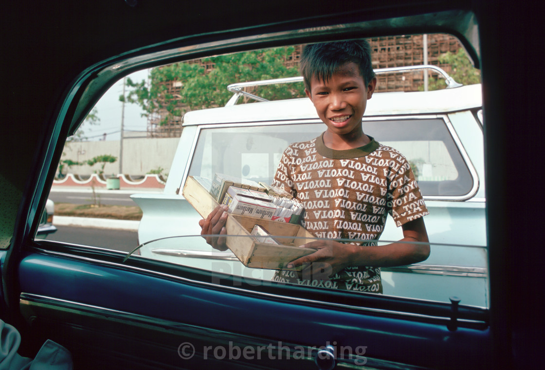 """Boy sells cigarettes at car windows in Manila, Philippines"" stock image"