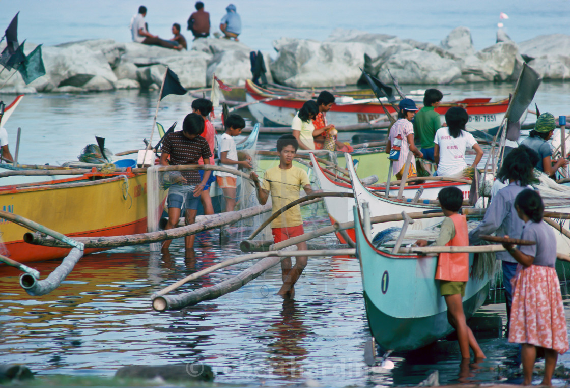"""Fishermen bring in their boats and their catch to the fish market in Manila,..."" stock image"