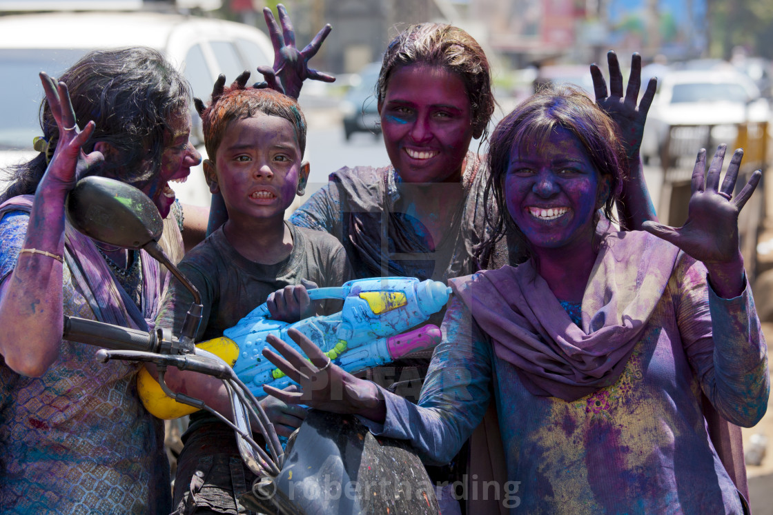 """Indian woman and child celebrating annual Hindu Holi festival of colours with..."" stock image"