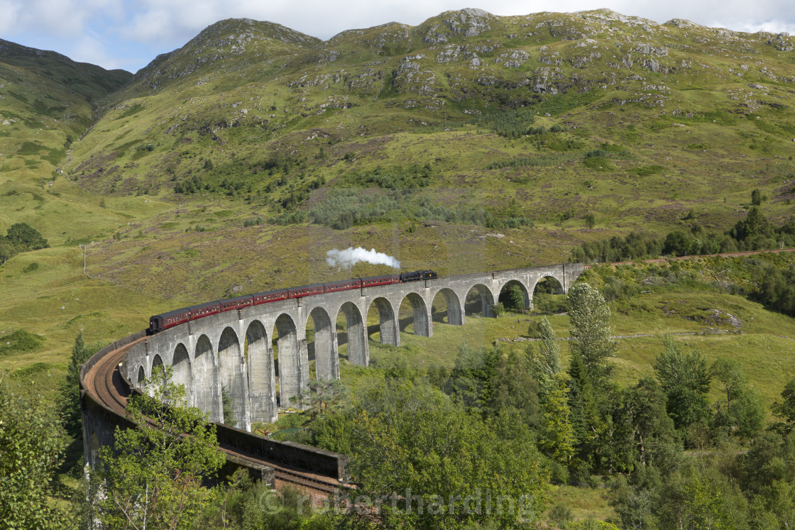 """The Jacobite steam train on the Glenfinnan Viadust on the Fort William to..."" stock image"