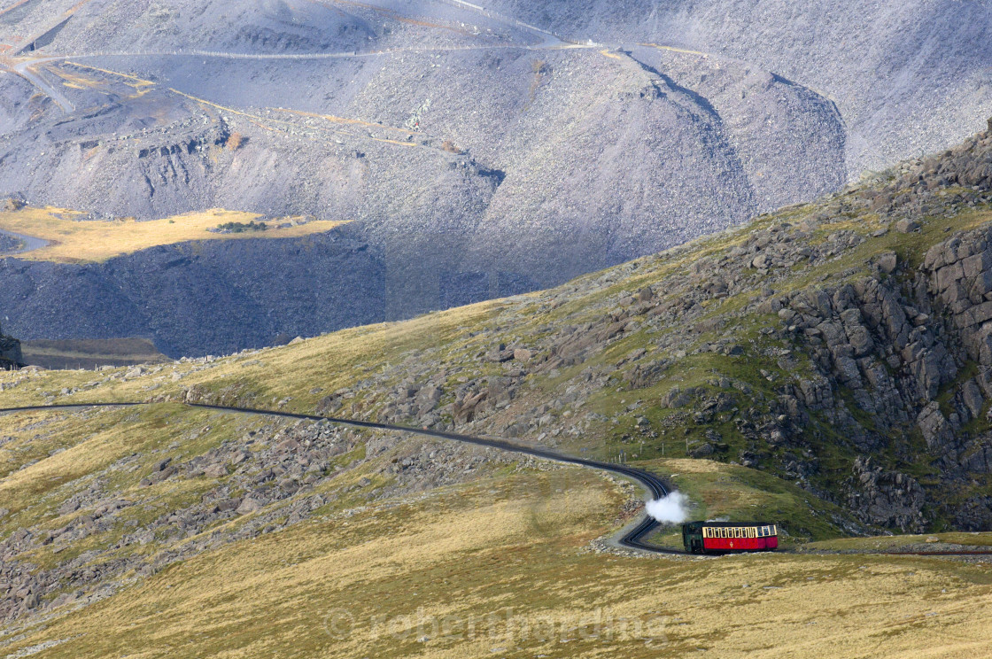 """Steam train on route between Llanberis and the summit of Mount Snowdon in..."" stock image"