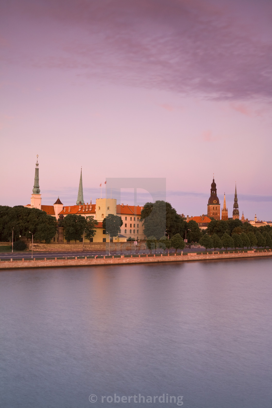 """Riga Castle and the River Daugava illuminated at sunset, Riga, Latvia, Europe"" stock image"