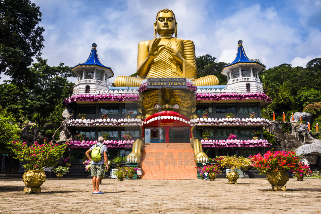 """""""Tourist visiting the Golden Temple of Dambulla in Dambulla, Central Province,..."""" stock image"""