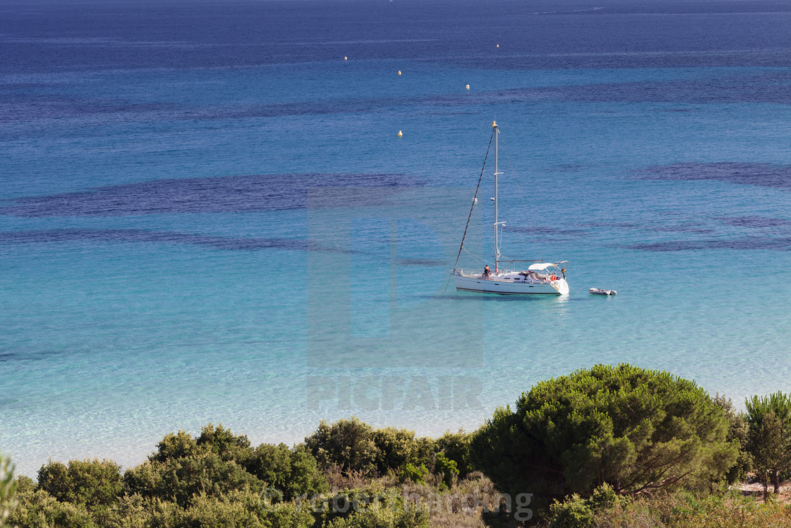 """Sailing boat at the beach of Palombaggia, Corsica, France"" stock image"