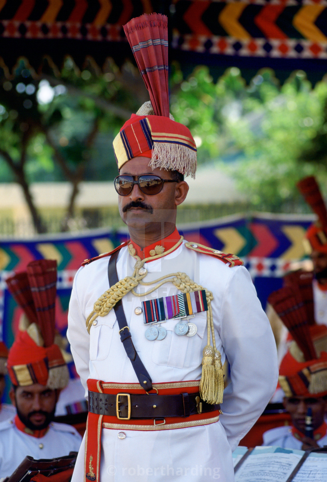 """Military man with medals standing at ease watching a parade in Pakistan"" stock image"