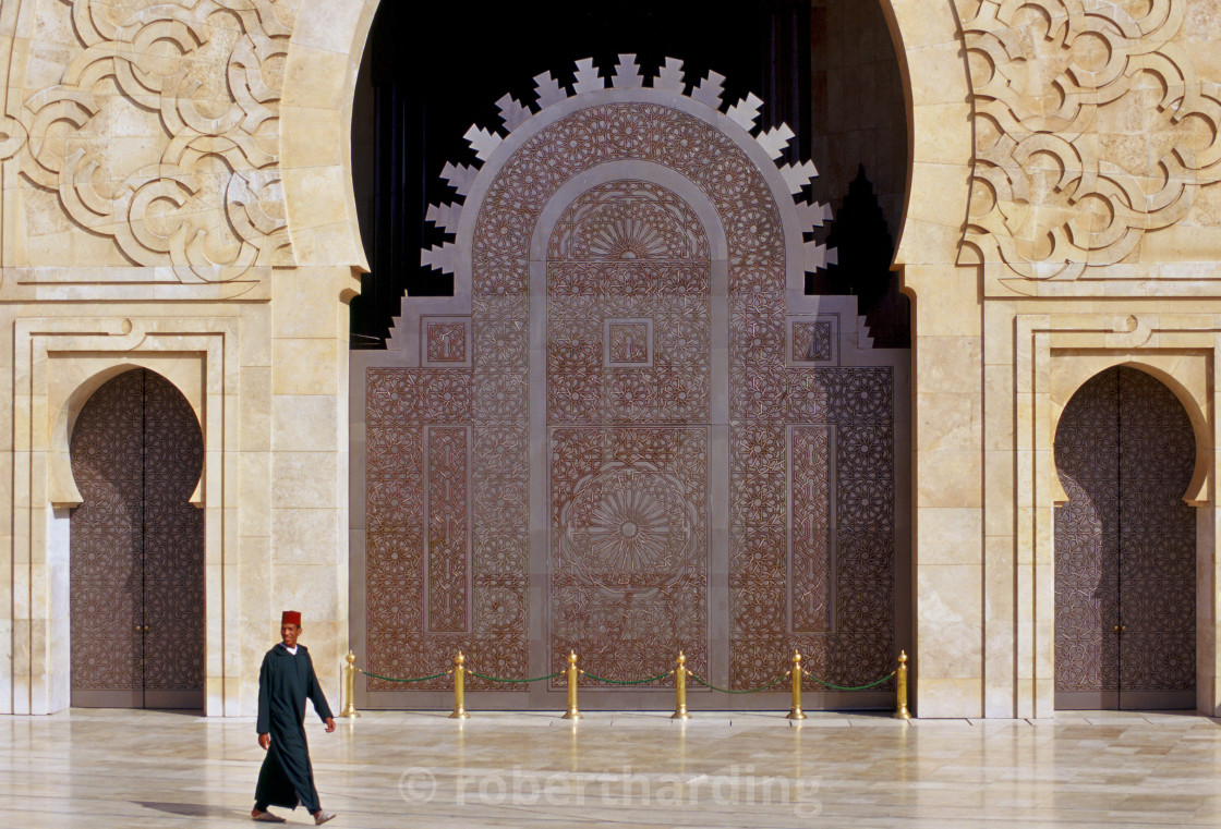 """""""Man walking outside Hassan II Mosque in Casablanca, Morocco"""" stock image"""