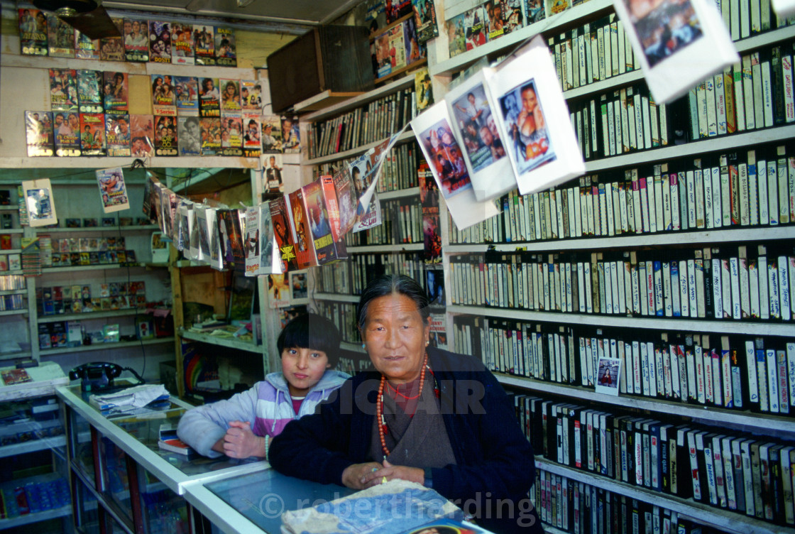 """Woman and child in video shop, Paro, Bhutan"" stock image"
