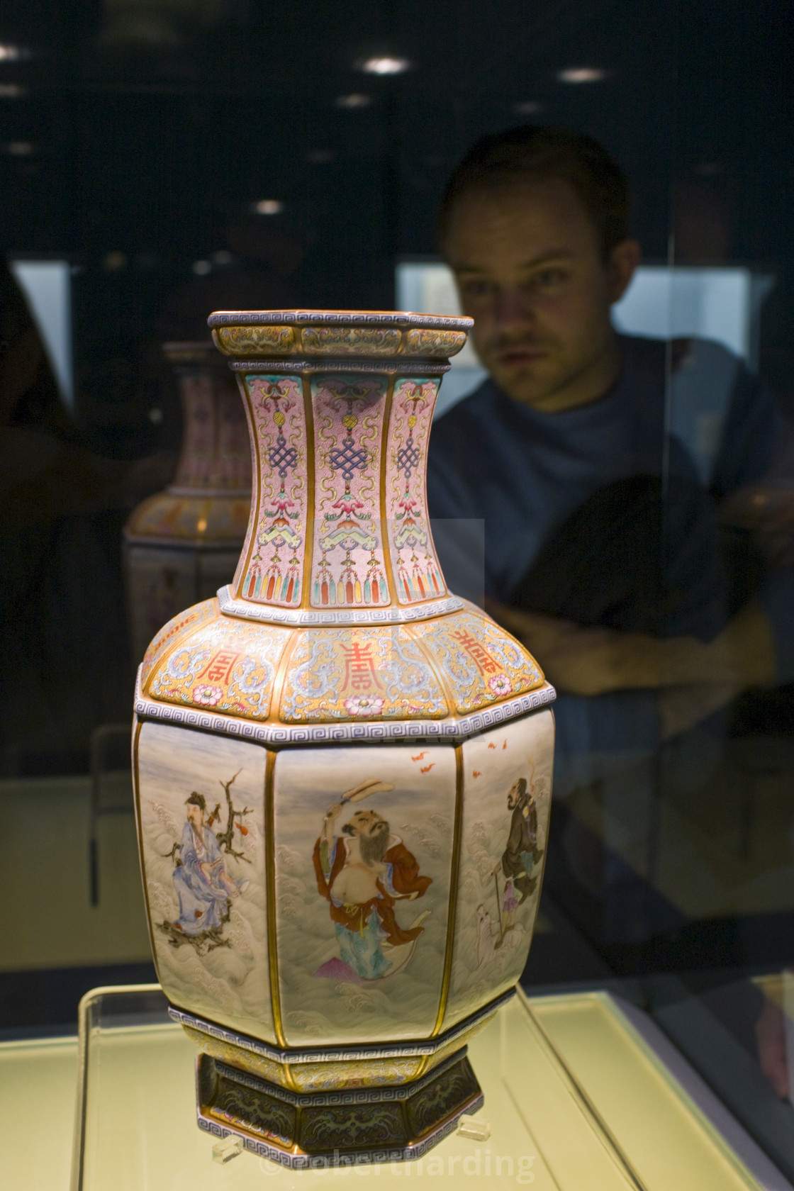"""""""Visitor looks at Ming vase on display in the Shanghai Museum, China"""" stock image"""