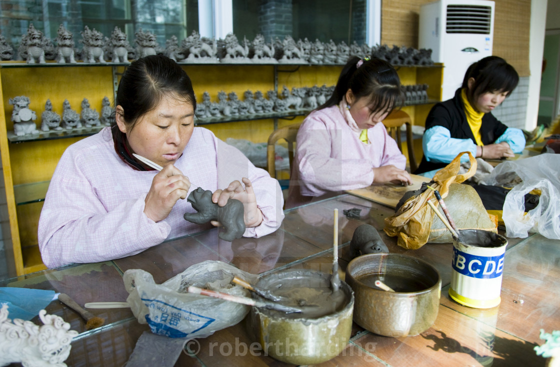 """Women make clay figure souvenirs in factory, Xian, China"" stock image"