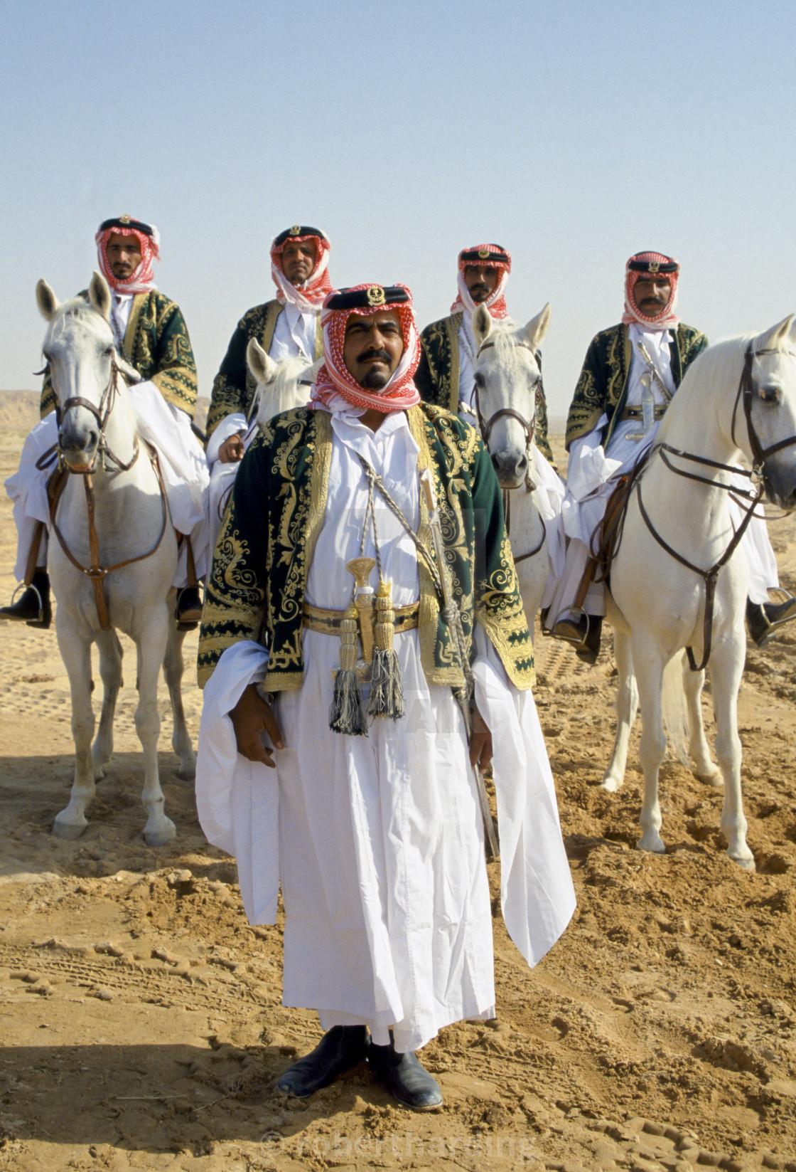 """Bedouins with horses in the desert in Saudi Arabia"" stock image"