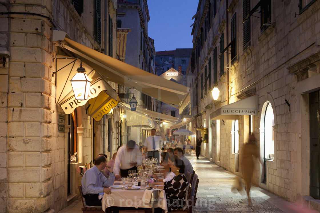 """""""People eating at outdoor restaurant at dusk in the old town, Dubrovnik,..."""" stock image"""
