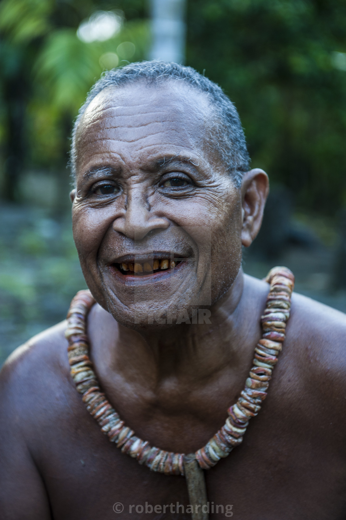 """Old islander on the Island of Yap, Micronesia"" stock image"