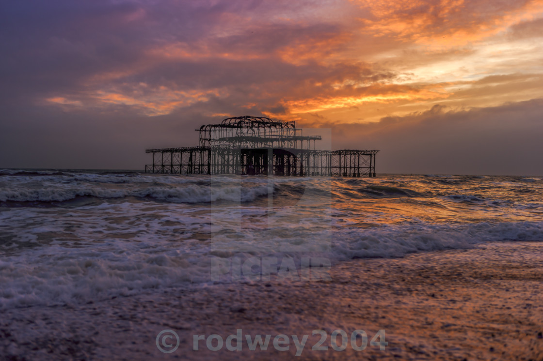"""Sunset On The Old Brighton Pier"" stock image"