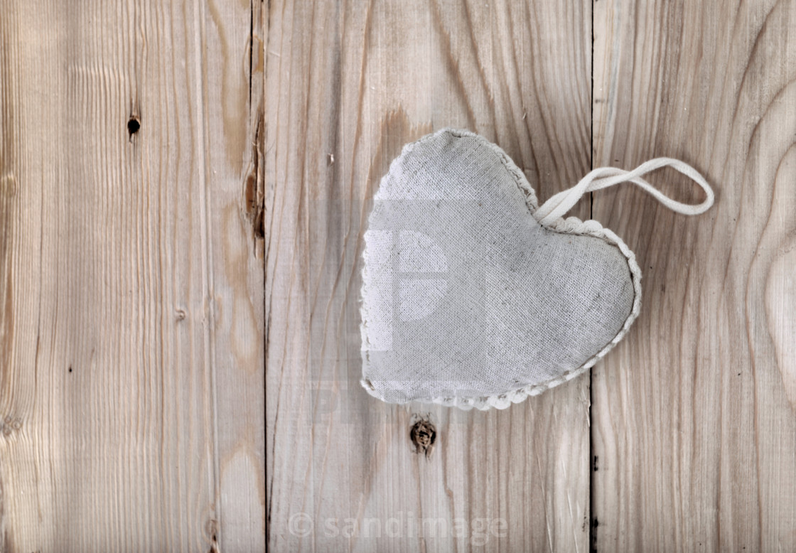 """""""heart-shaped pillow on plank"""" stock image"""