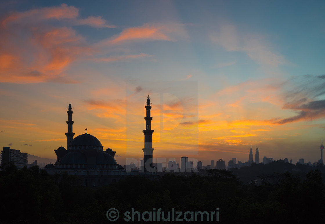 """Sunrise over Federal Territory Mosque"" stock image"