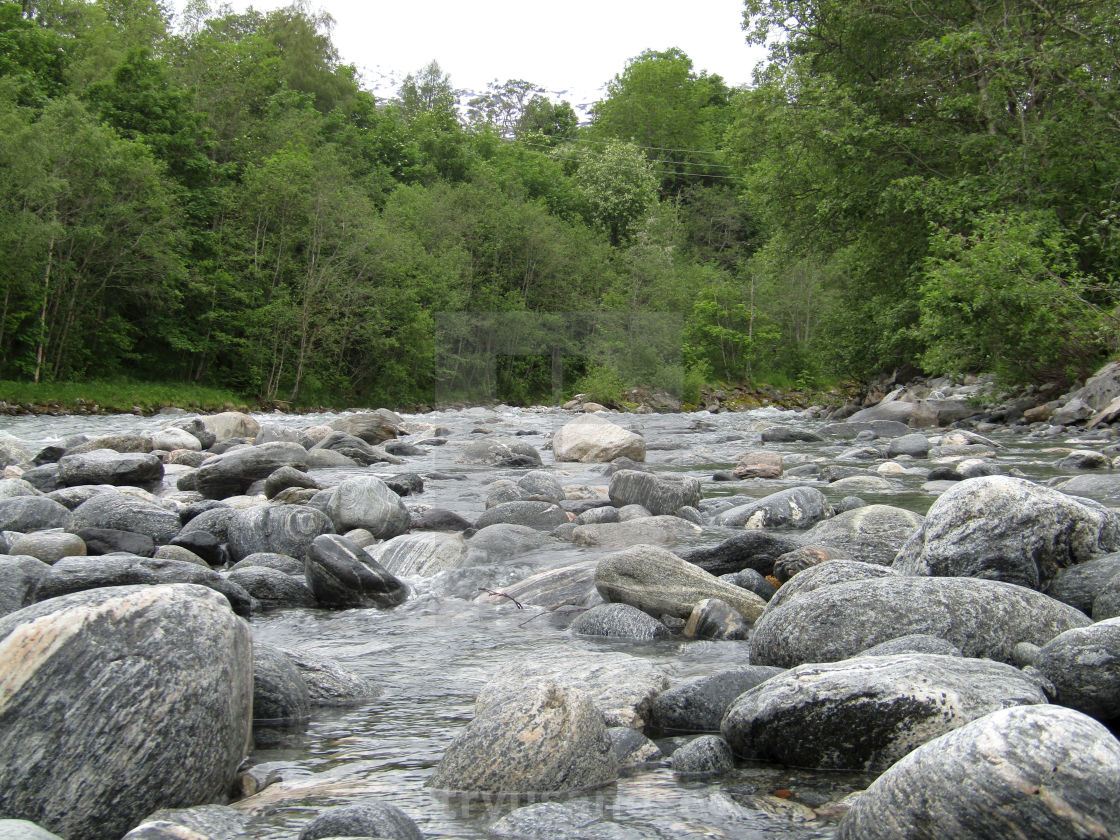 """Stranda, Norway river with boulders"" stock image"