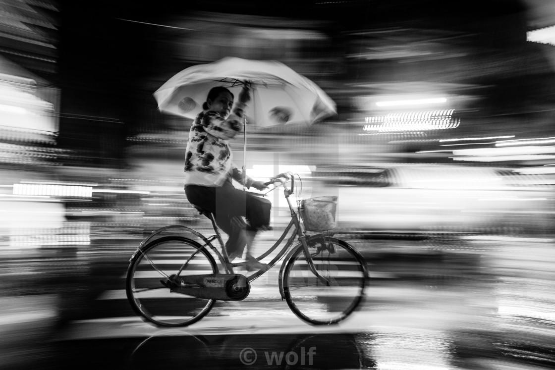 """Cyclist in the rain"" stock image"