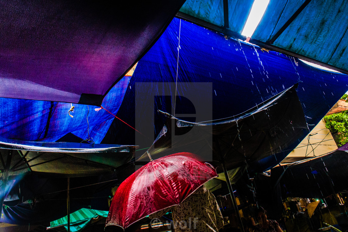 """Rainning in the market"" stock image"