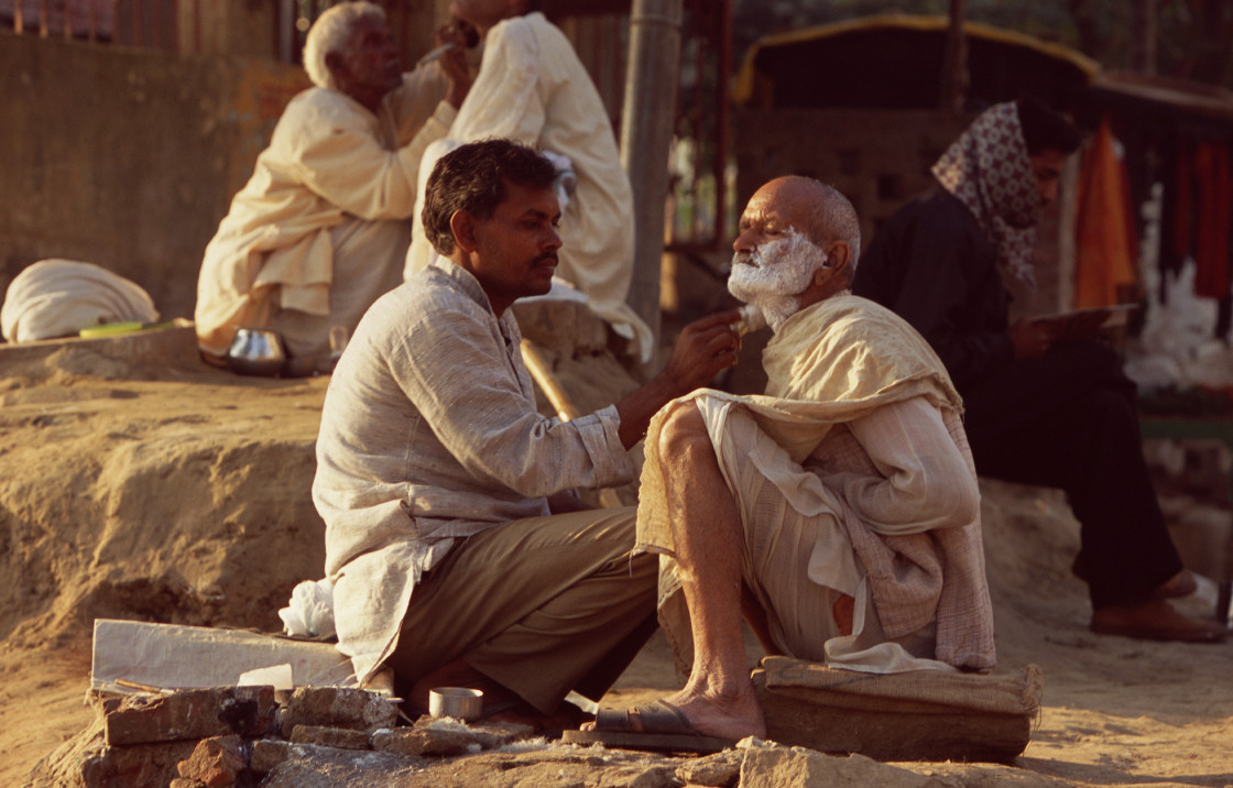 """Man getting haircut and shave, Varanasi, India"" stock image"
