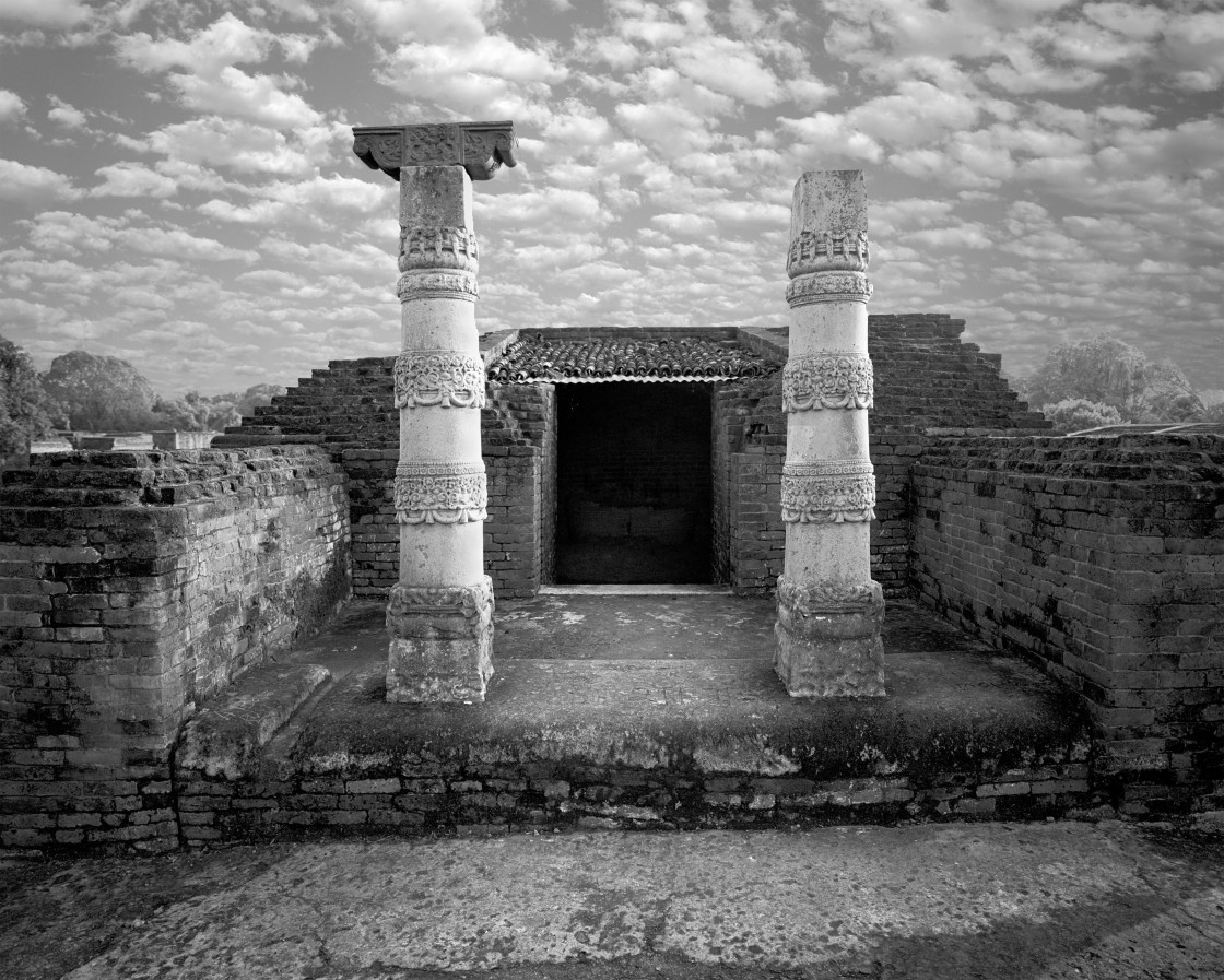 """Pillar and Temple entrance, Nalanda, India"" stock image"
