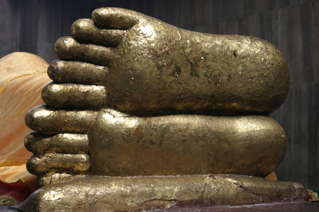 """Feet of Buddha, Kushinigar, India"" stock image"