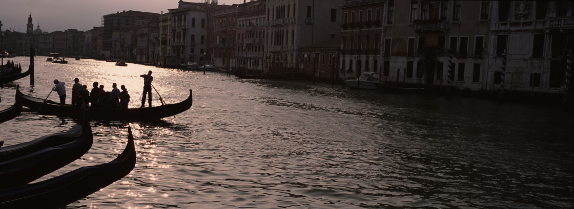 """Gondola ride, sunset, Venice"" stock image"