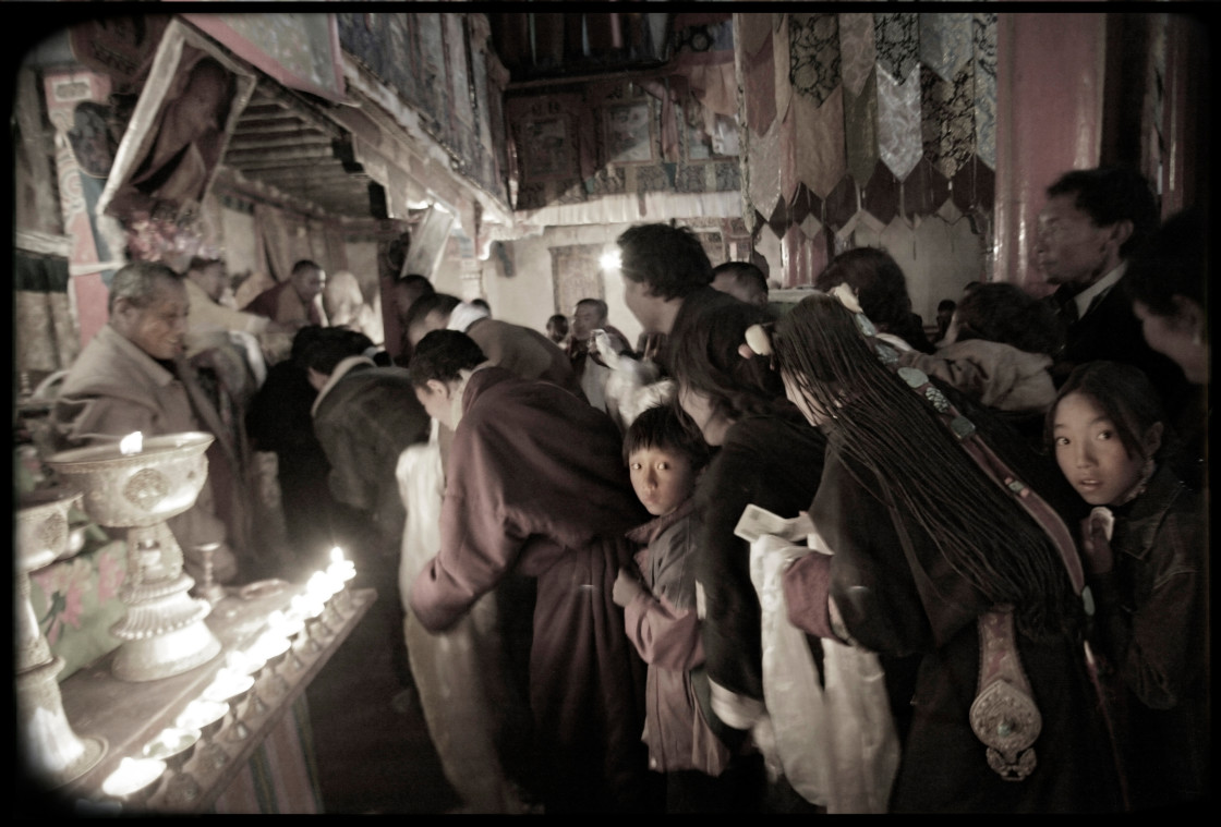 """Khampa nomads in prayer line in temple, Nangchen, Tibet"" stock image"